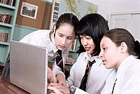 Schoolgirls Using Laptop