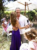 Couple Dancing at a Family Garden Party