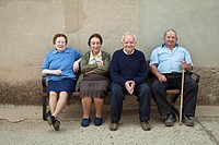Local people sitting on a bench seat in the village of Las Matillas along the Camino de Santiago