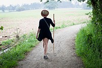 A women walking the Camino de Santiago near the village of Casanova