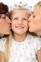 Girl Wearing Tiara Being Kissed by Two Women