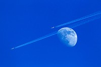 two plane fly close the moon