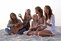 Women Singing on Beach