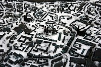 snow_covered bronze model of the city containing Braille text, Germany, North Rhine_Westphalia, Muenster