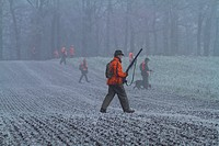 hunters on field in november, Germany