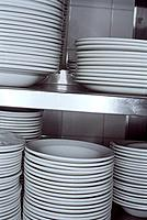 Stacked Plates on Shelf