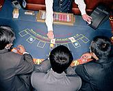 Businessmen Playing Blackjack