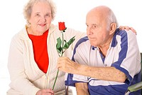 shot of a handicap man giving his wife a rose