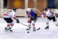 Hockey Players Pursuing Opponent