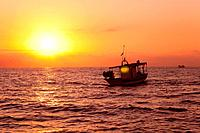 fishing boat in sunrise at Mediterranean sea traditional fishery