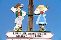 geography / travel, Austria, Styria, tradition / folklore, Kitzeck, Sausaler Weinstrasse Sausal Wine Route, sign post, figures in traditional costumes...