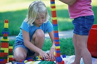 Two Girls Playing with Plastic Blocks