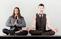 Two businessmen meditating
