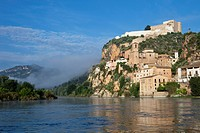 Ebro River Ria Ebre,Templar castle, early morning mist,mountains,swift flowing water,reflection
