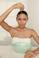 Woman dripping water into bowl