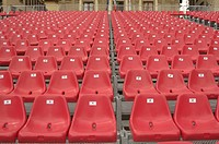 Most of those pretty red plastic seats need to be occupied before the event can be considered a success.