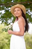 girl wearing summer hat