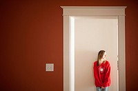 Young girl in doorway of a home