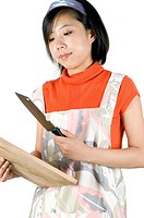 Young girl cooking, cutting