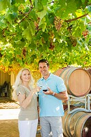Couple tasting wine at winery