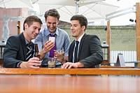 Businessmen having drinks on patio