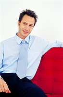 Smiling businessman sitting on couch