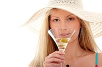Woman drinking martini with olive