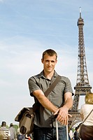Man posing in front of Eiffel Tower, Paris, France