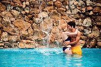 Young couple in swimming pool (thumbnail)