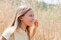 Blonde girl in field, portrait (thumbnail)