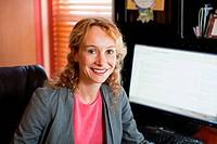 Businesswoman in home office, portrait