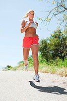 Woman jogging on path