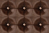 Seamless luxury buttoned brown leather pattern.