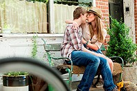 Young couple kissing on bench