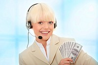 Businesswoman with headset holding dollars.