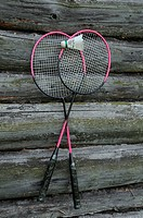 Badminton Rackets and Birdie on the Wooden Wall