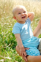 Adorable baby boy outdoors