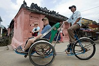 Tourist rickshaw at landmark Japanese Covered Bridge Hoi An Vietnam