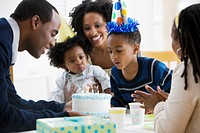 African American family celebrating son´s birthday