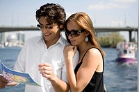 Couple looking at map, Vancouver, British Columbia