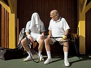 Two Tennis Players Sitting on Bench