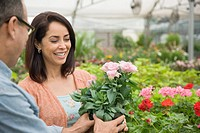 Florist helping customer in nursery