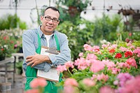 Hispanic florist working in nursery