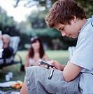 Teenage Boys with MP3 Player