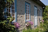 Partial view of an Old Canadiana circa 1850 Fieldstone Cottage style Residential Home, Quebec, Canada. This image is property released. PR0140