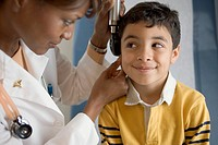 Doctor Checking Boy´s Ears