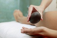 Placing Stone in Hand During LaStone Therapy