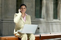 Businesswoman with Cell Phone and Laptop, Toronto, Ontario