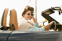Woman Driving Convertible Sports Car
