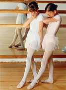 Two girls in a ballet room